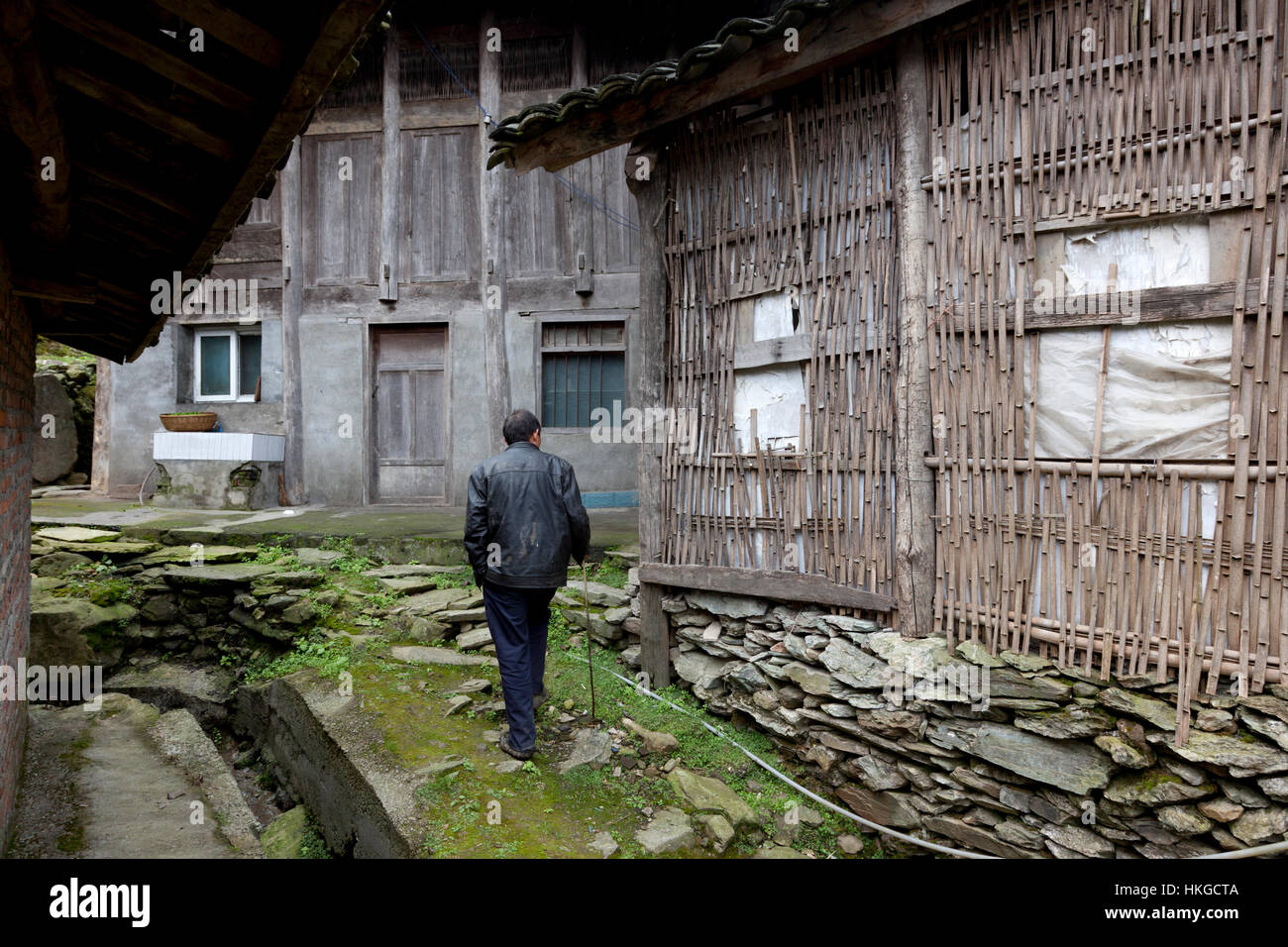 Farmhouses at a remote mountain village in the mountains of west China are variedly constructed of rubble stones, - Stock Image