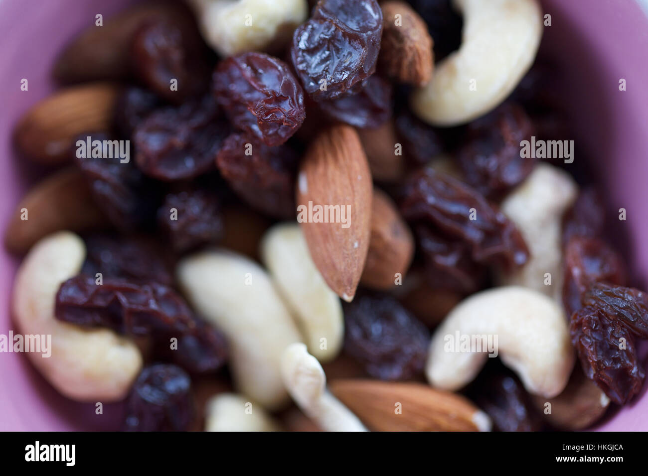 mixed dried fruit and nuts. almond, cashew, raisin, nutrition. - Stock Image