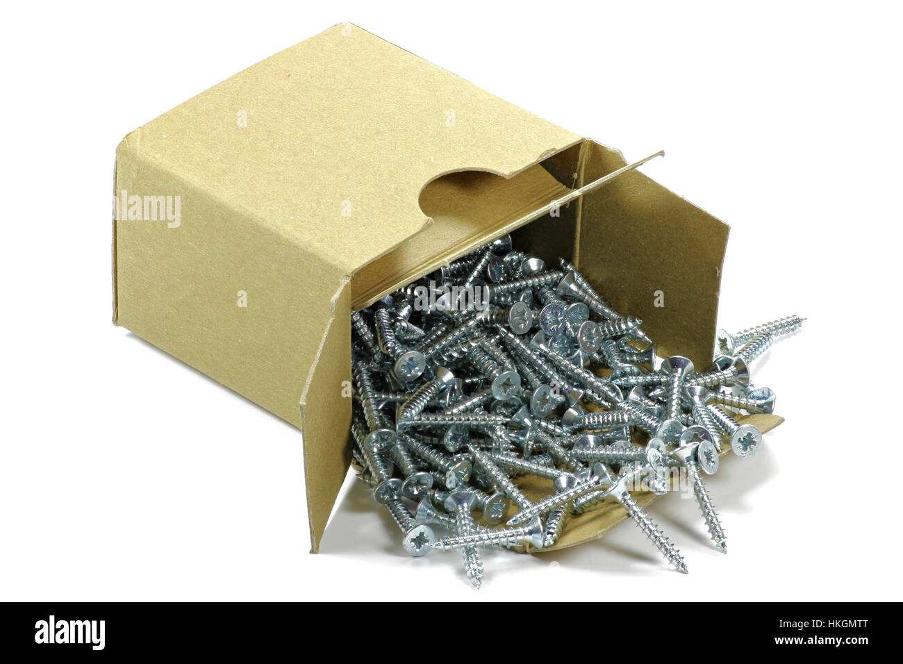 universal screws in a cardboard container isolated on white background - Stock Image