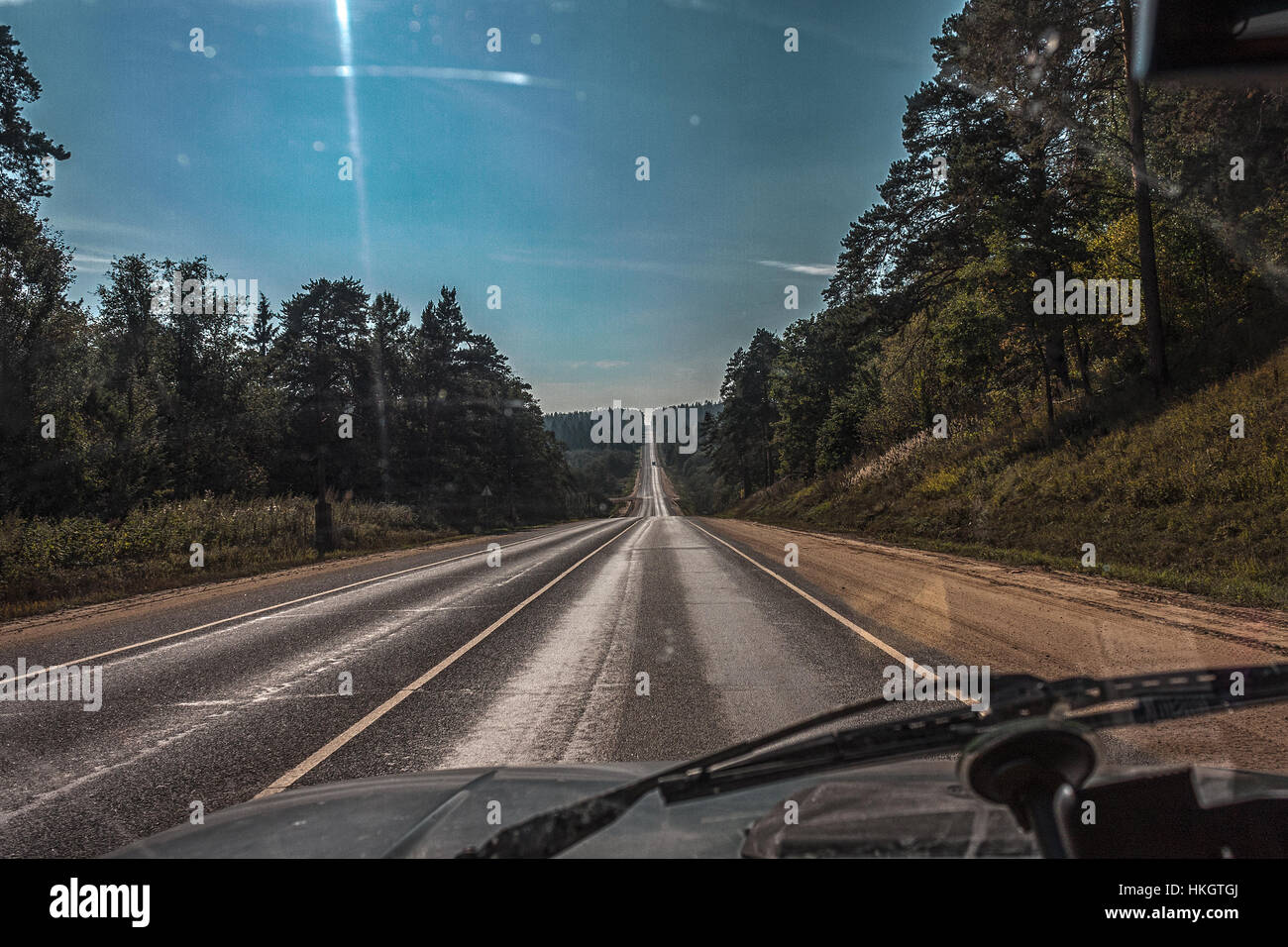 empty summer road at noon - Stock Image