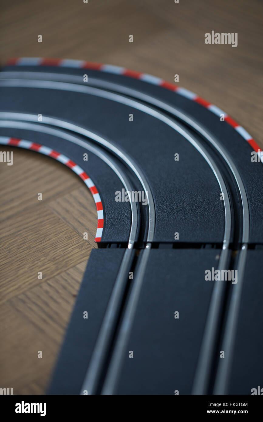 toy racing track. game, children's room, wooden floor, racetrack. Stock Photo