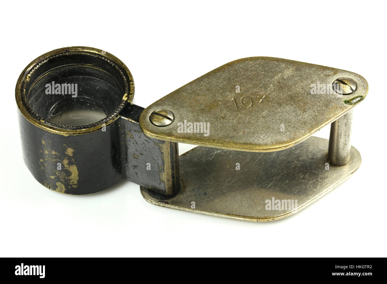 vintage folding magnifier with 10x magnification isolated on white background - Stock Image