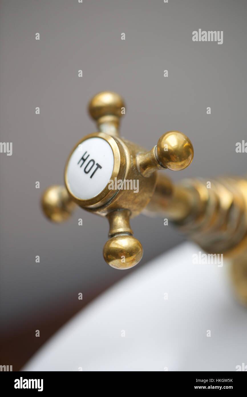 close up of hot water tap in bathroom. faucet, tap, design, metal. - Stock Image