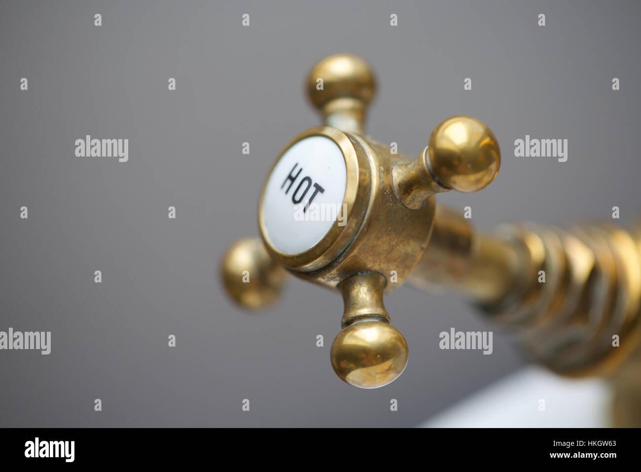 close up of hot water tap. faucet, tap, design, metal. - Stock Image