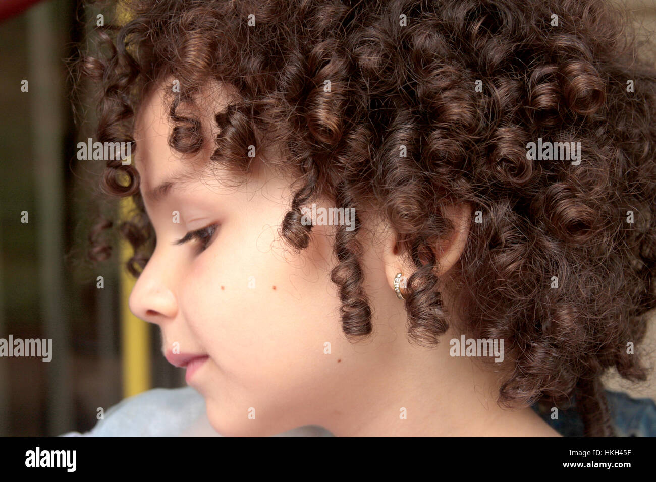 Little Caucasian Girl With Natural Curly Hair Stock Photo