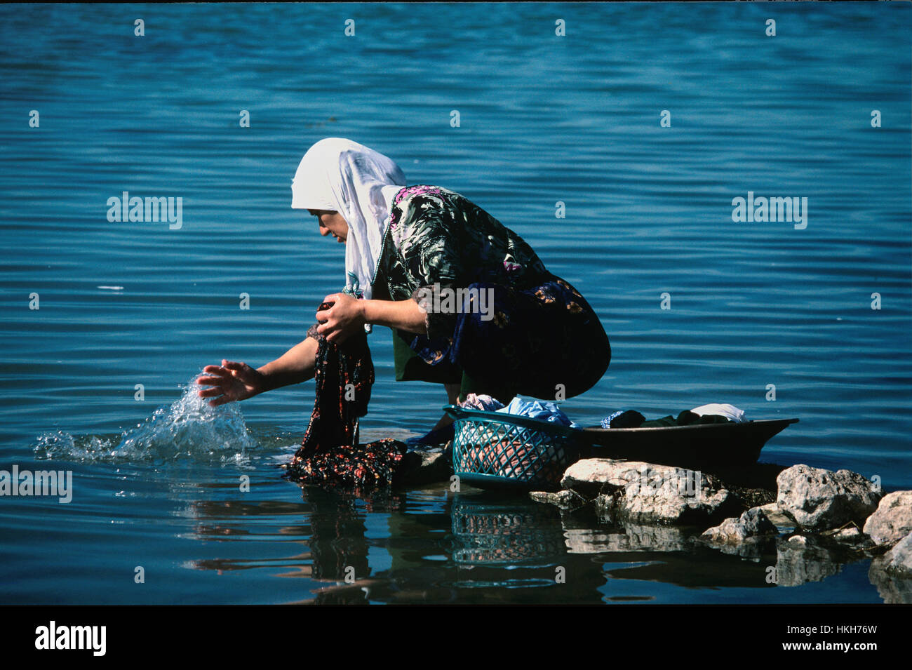 Turkish Peasant Woman Washing Clothes or Doing the Laundry in Beysehir Lake Turkey - Stock Image