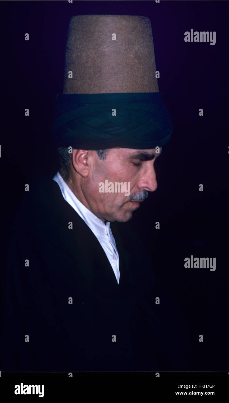 Portrait of Chief Whirling Dervish Wearing Traditional Felt Fez Konya Turkey - Stock Image