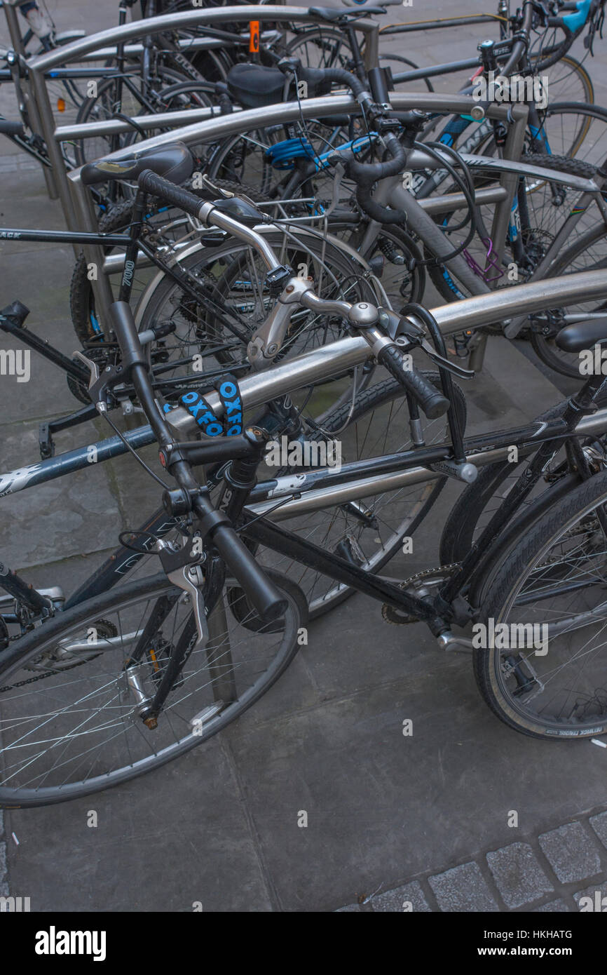 Cycle rack / rank in the City of London financial district. Focus on forward bikes. Metaphor for getting around - Stock Image