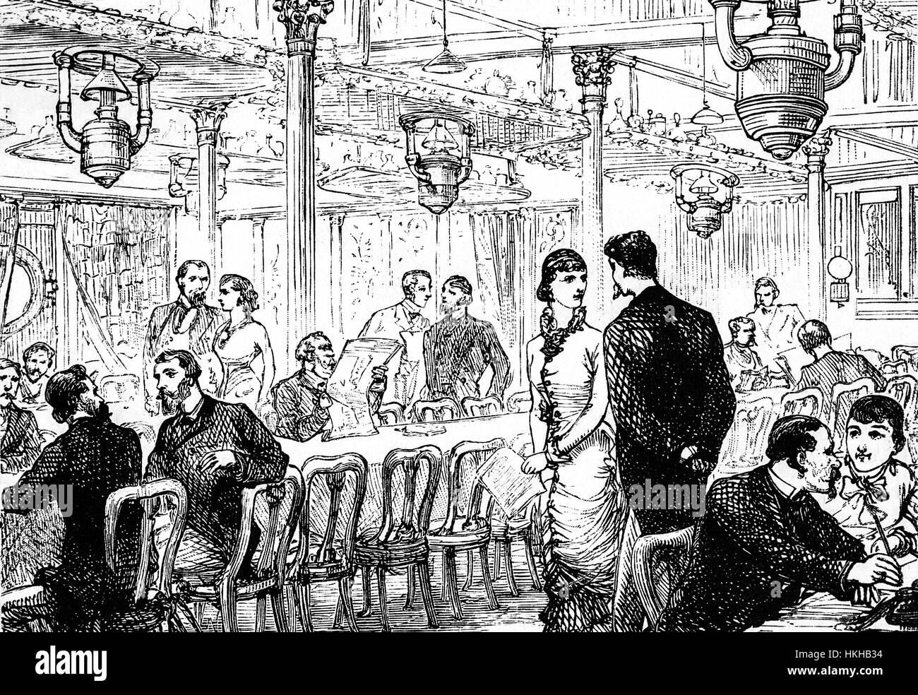 1879: Passengers in the saloon of the Cunard SS 'Scythia' making the Atlantic crossing from Liverpool, England - Stock Image
