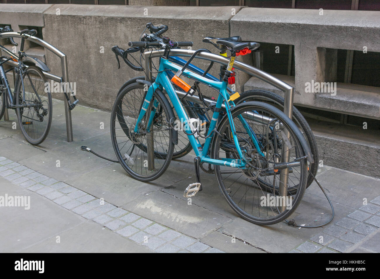 Cycle rack / rank in the City of London financial district. Metaphor for getting around London, working in London, - Stock Image