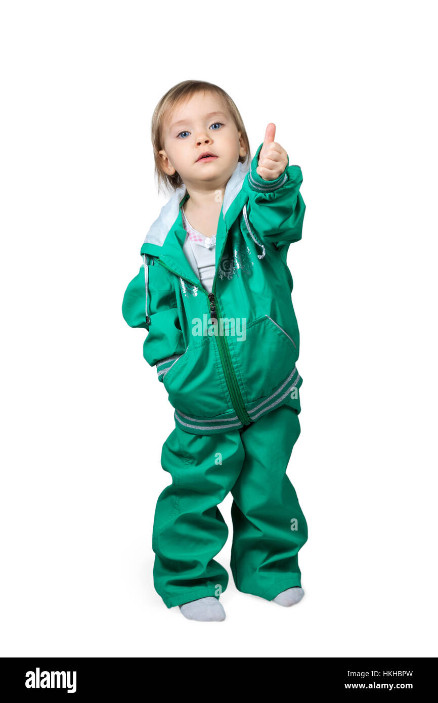 Child in sports suit raised thumb up - Stock Image