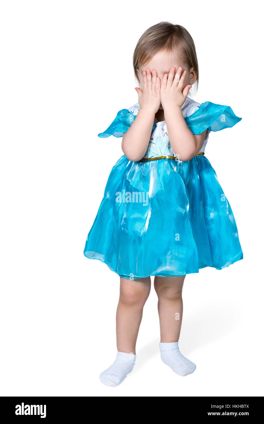 Girl closed her eyes with hands - Stock Image