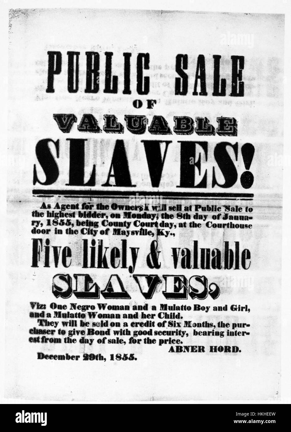 A poster advertising a slave sale, two women and three children are being sold at the auction, they are being offered - Stock Image