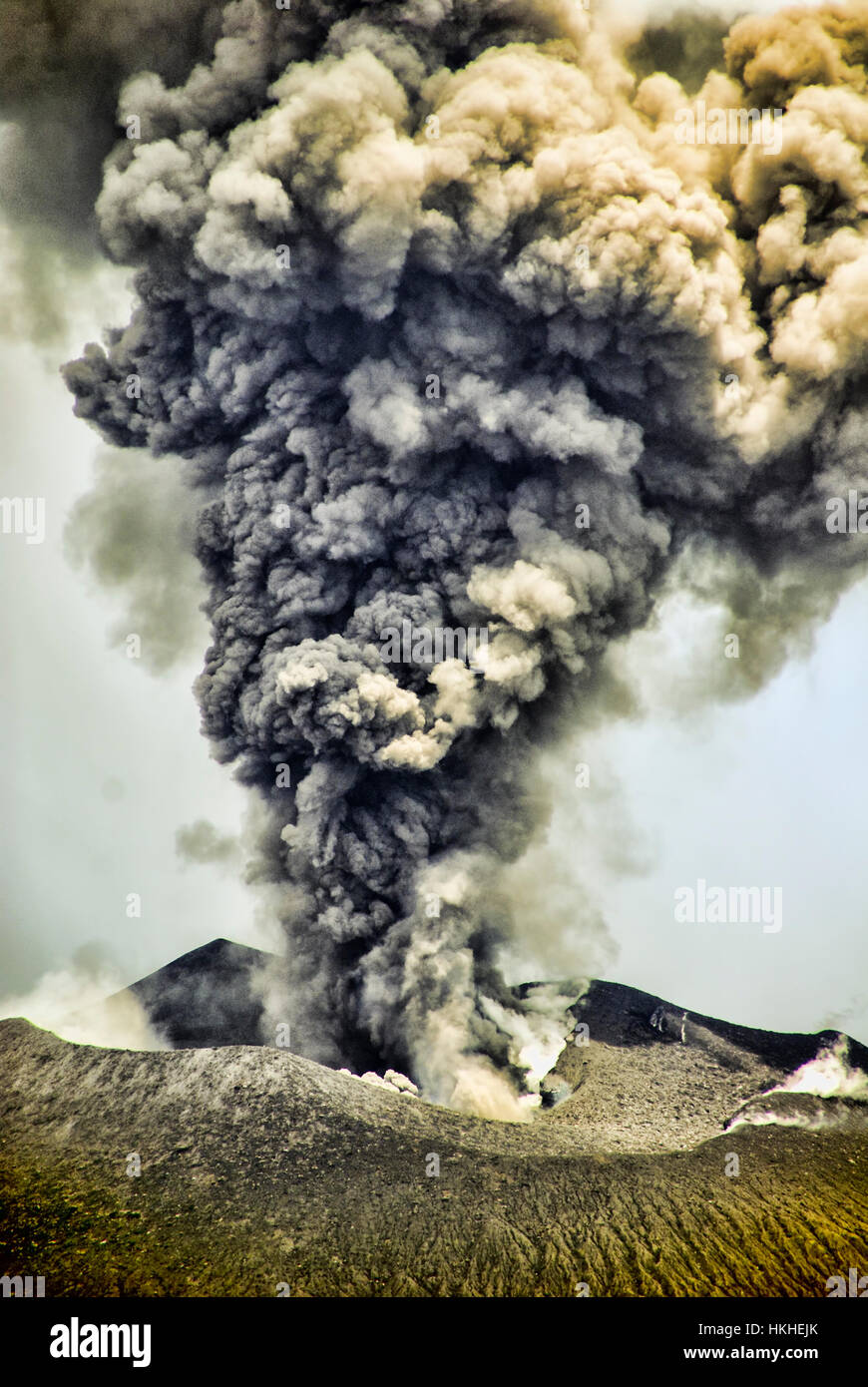 A view of the caldara of Mt. Tavurvur volcano when it is erupting. This is near the town of Rabaul, Papua New Guinea. - Stock Image