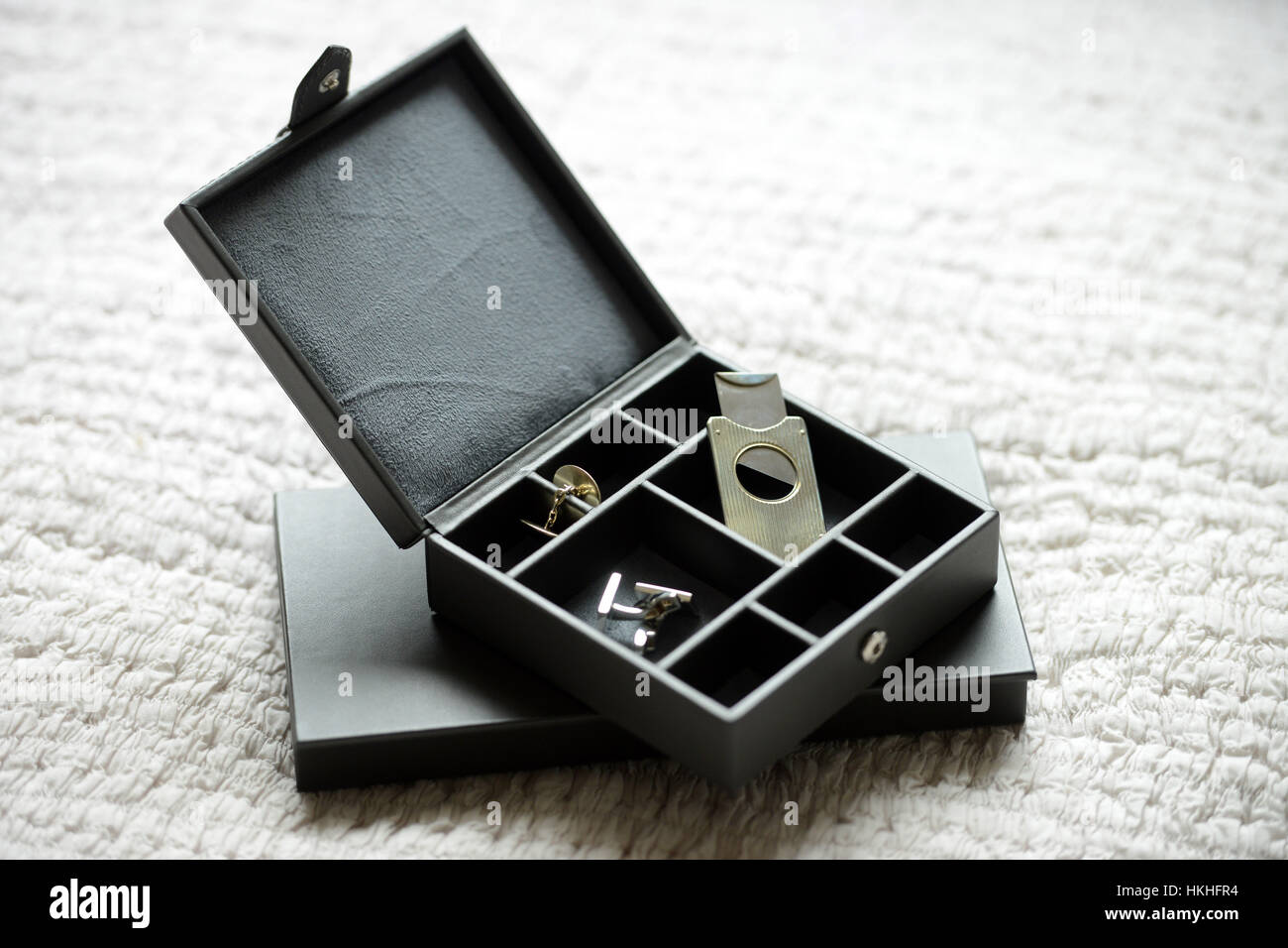 Brown leather box with bow tie cigar cutter and cufflinks - Stock Image