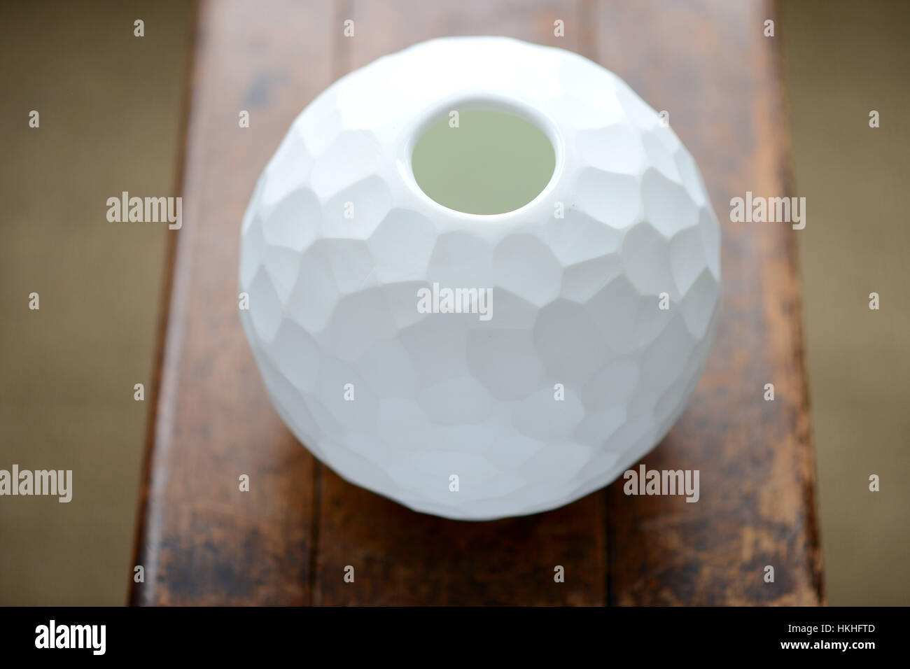 Round cut glass vase with decorative pattern - Stock Image