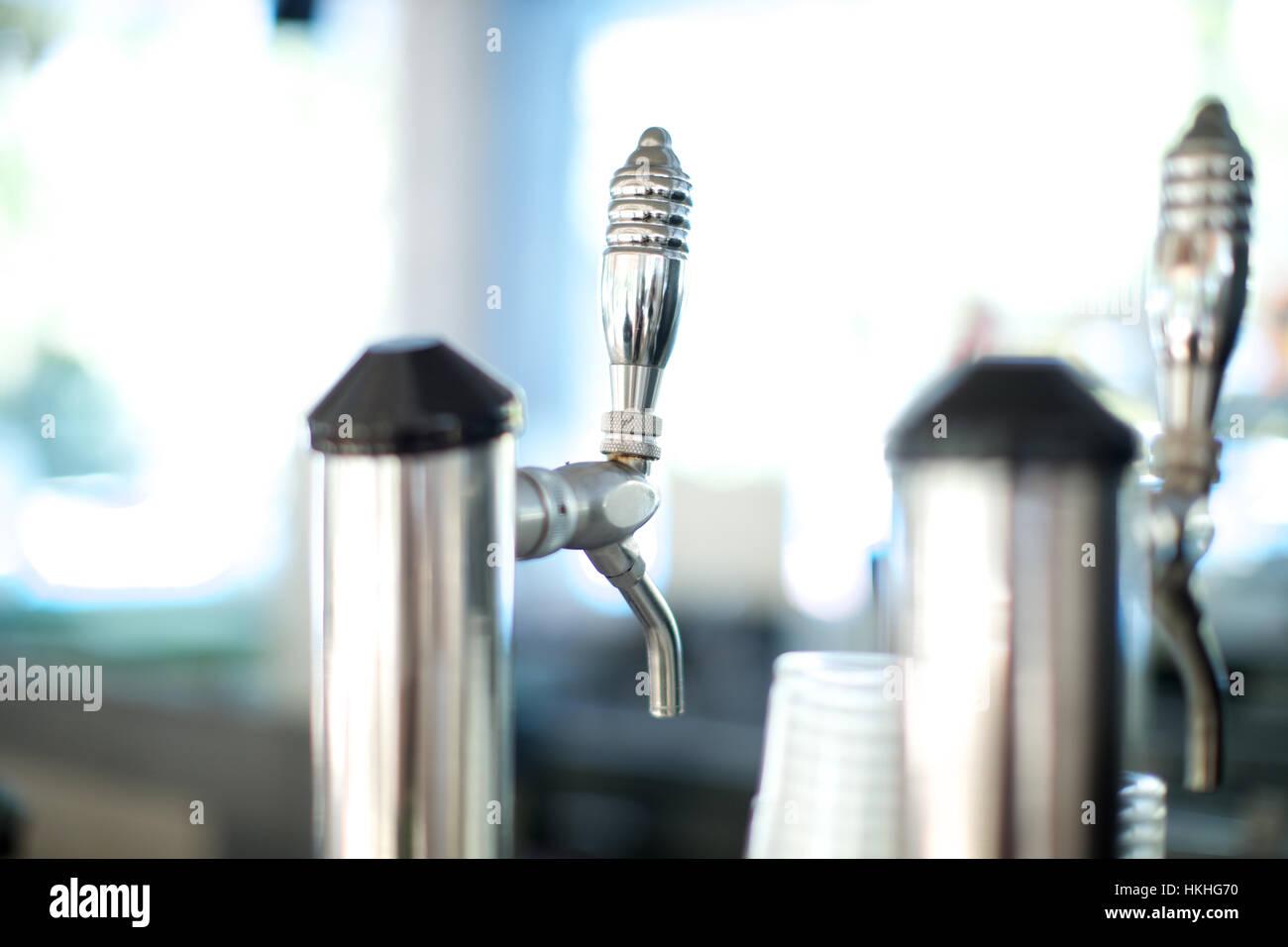 draft beer pump at bar. alcohol, beverage, beer, close up. - Stock Image