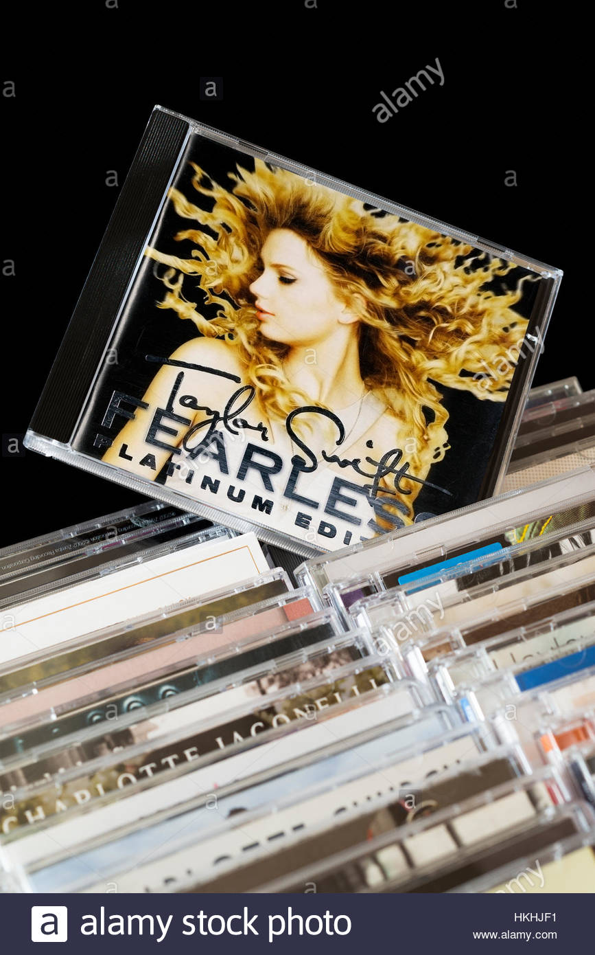 Fearless, Taylor Swift CD pulled out from among rows of other CD's - Stock Image