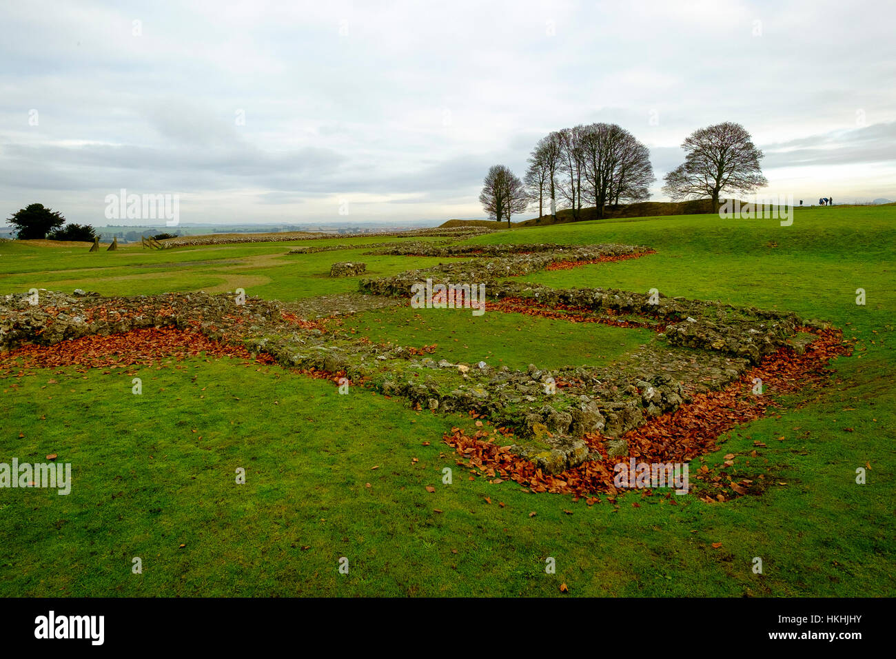 The ruins of the old cathedral within the grounds of Old Sarum, Salisbury stand in winter amidst red fallen leaves Stock Photo