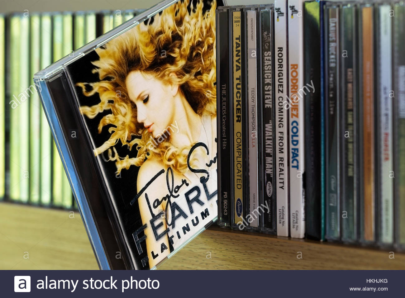 Fearless, Taylor Swift CD pulled out from among other CD's on a shelf - Stock Image