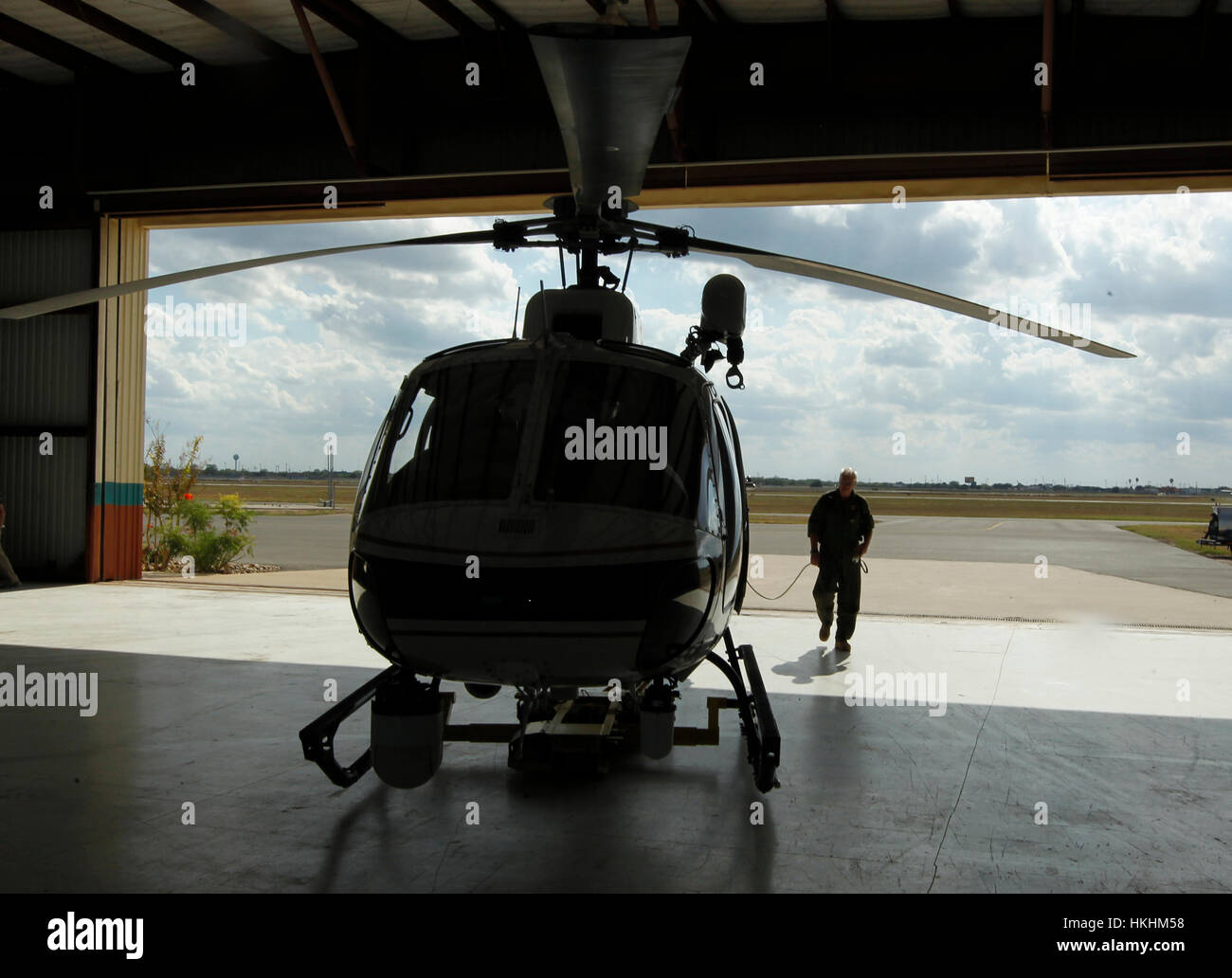 10/13/11 -  Texas Department of Public Safety pilot Lt. Johhny Prince II rolls the helicopter into the hangar after Stock Photo