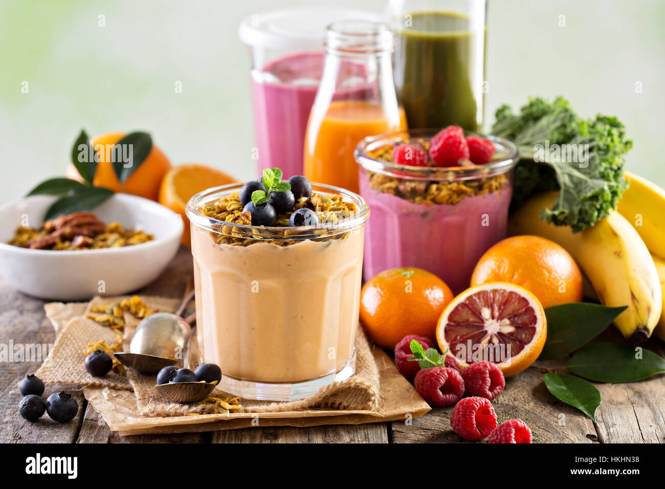 Orange mango smoothie with granola - Stock Image