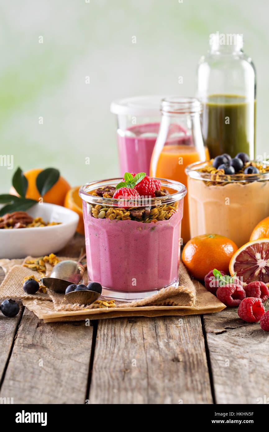 Healthy orange and raspberry smoothie - Stock Image