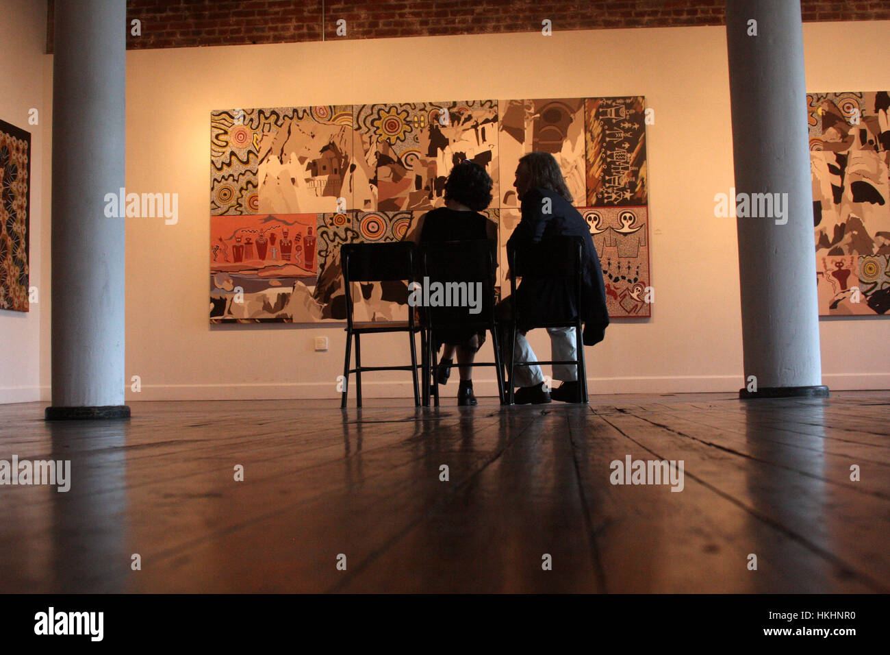 Man and woman in art gallery - Stock Image