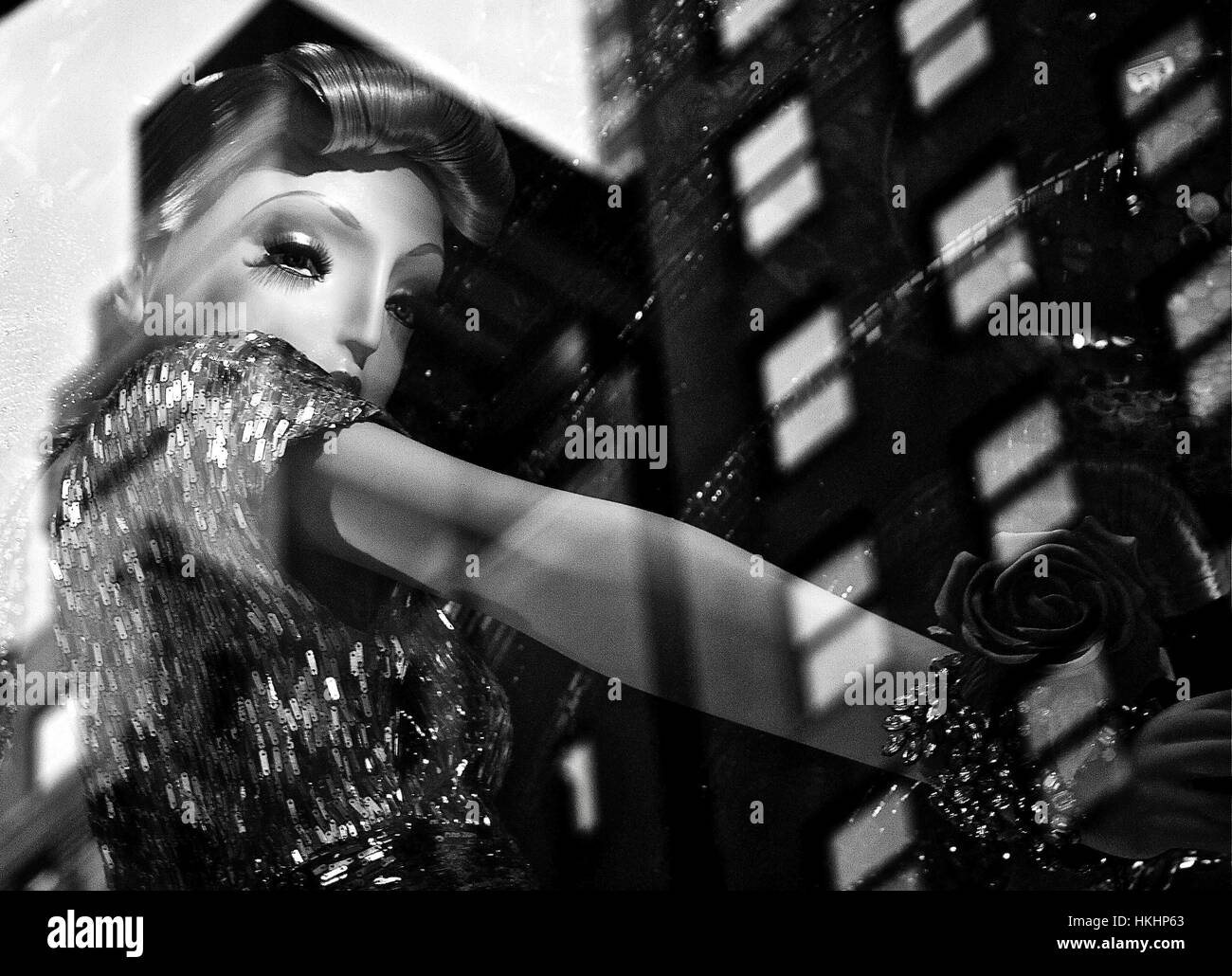 Black and white image of a 50s style mannequin with window reflection taken january in new