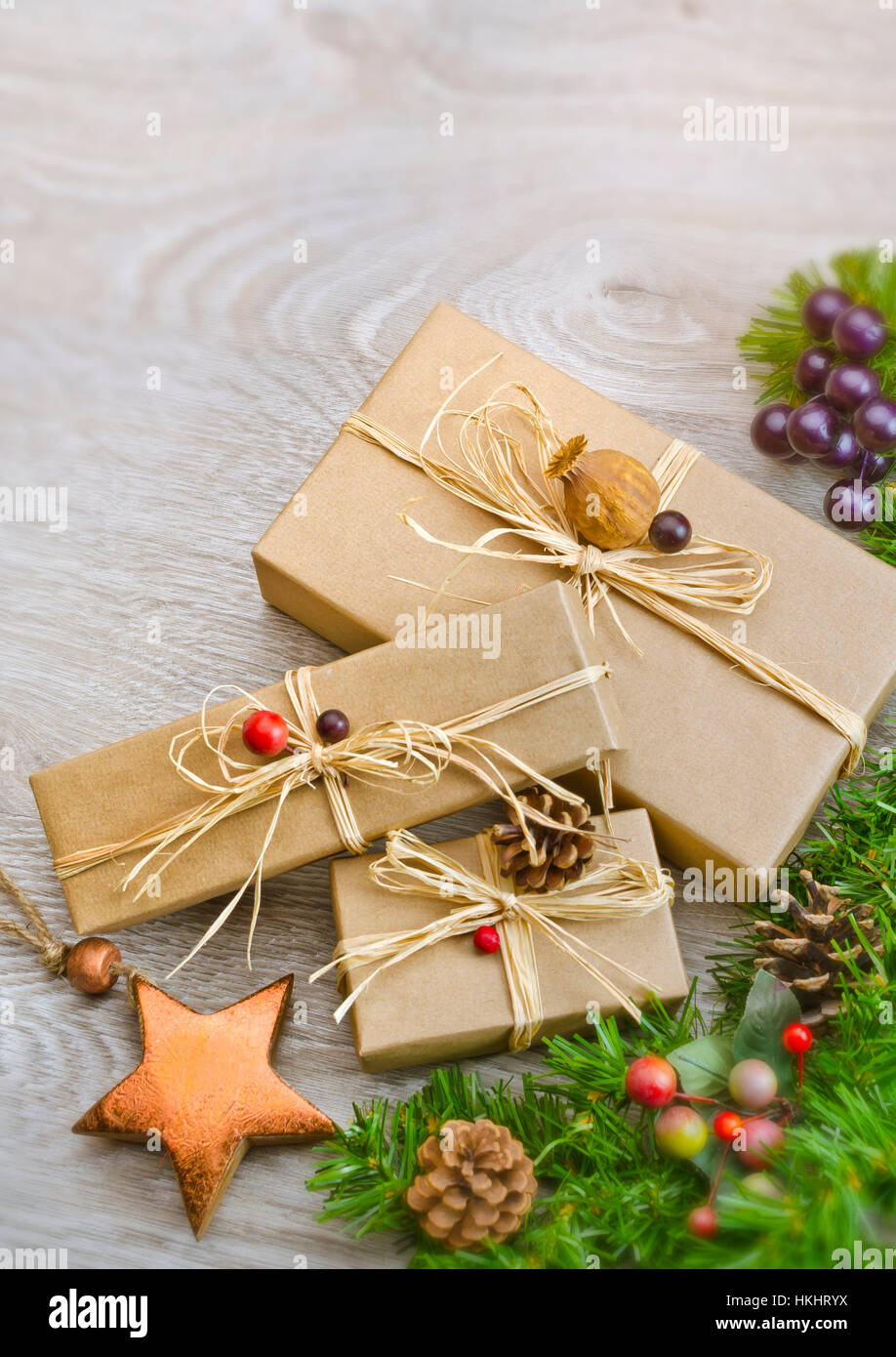 Contemporary wrapped presents on wooden background with space at top for copy - Stock Image