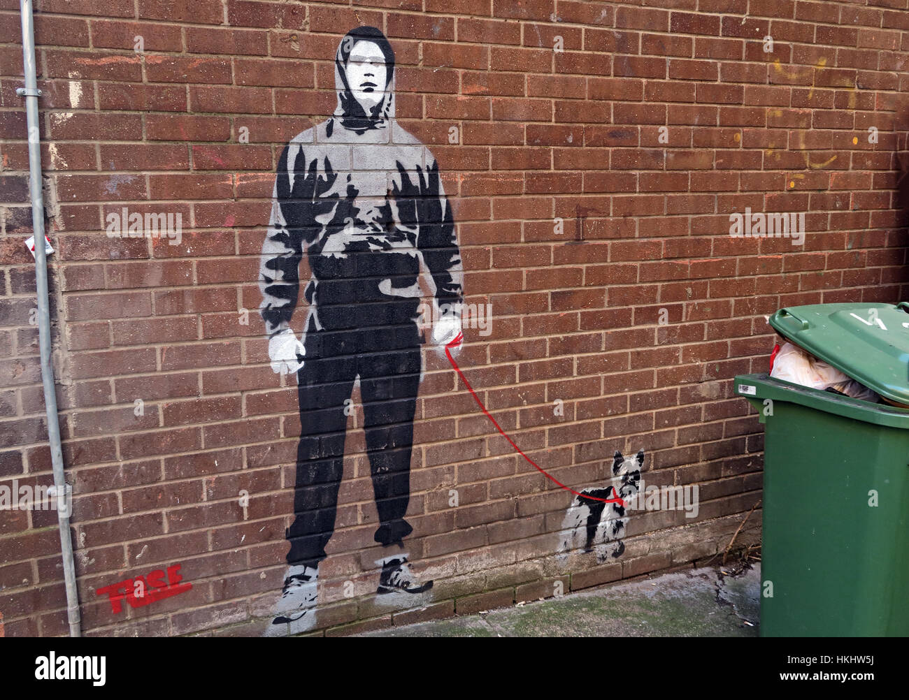 Boy walking dog stencil,Glasgow Queen St, Scotland - Stock Image