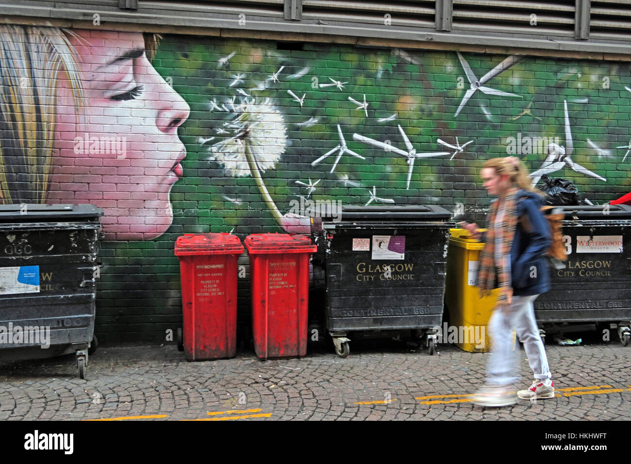 Girl blowing flower, Glasgow Stock Photo