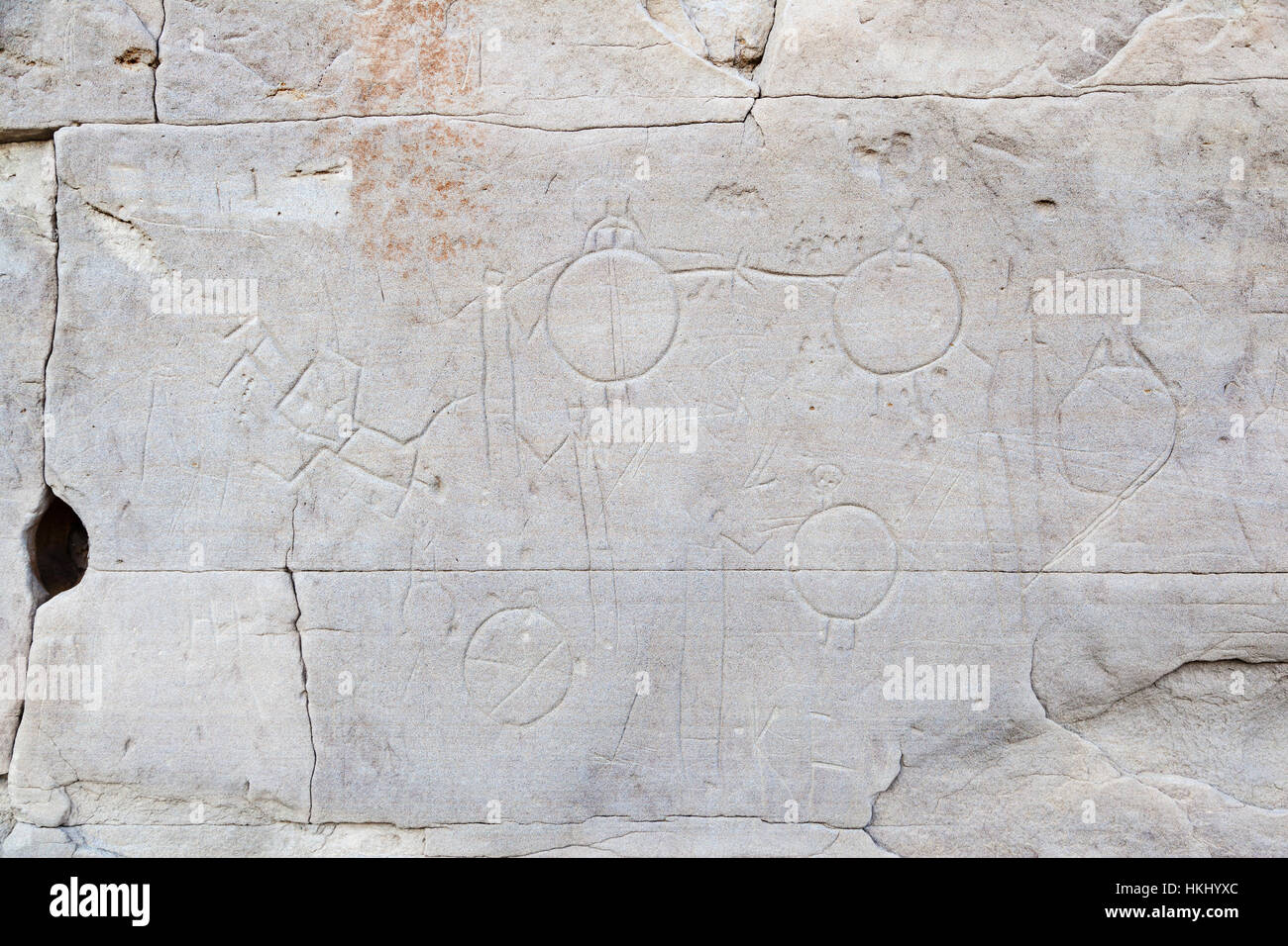 Native rock carvings at Writing-On-Stone Provincial Park and Aisinaipi National Historic Site in Alberta, Canada. - Stock Image
