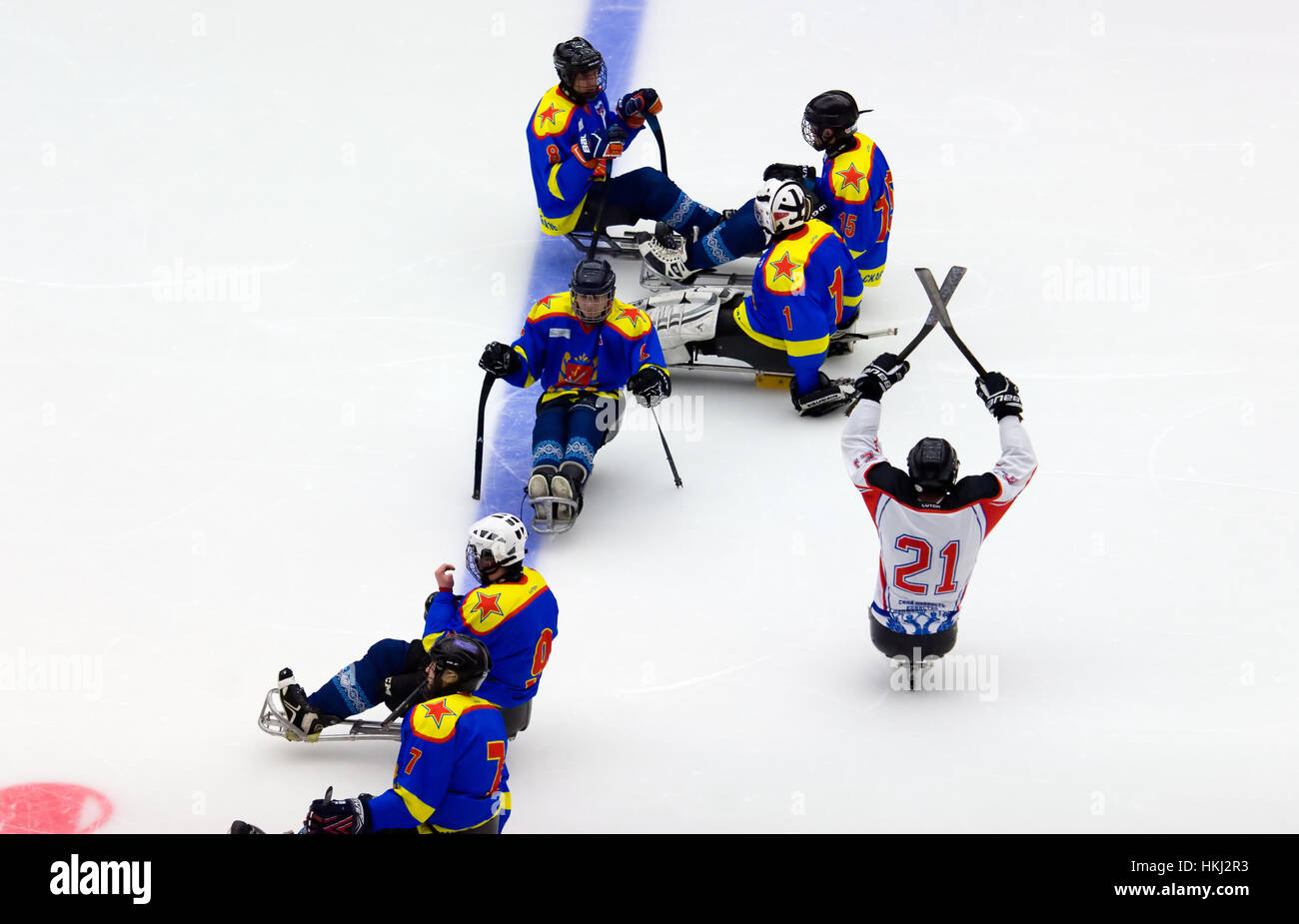 PODOLSK, RUSSIA - JANUARY 14, 2017: Unidentified players of Ladoga (blue) and Zvezda (white)  team of Sledge hockey during game Vityaz vs AKBars on Russia KHL championship on January 14, 2017 Stock Photo