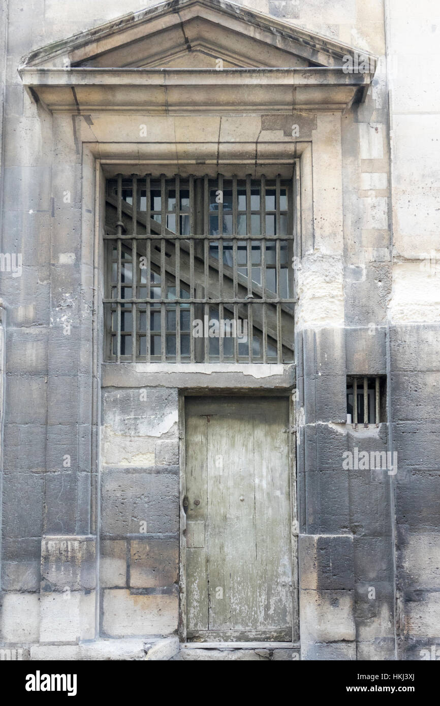 Old door on the Eglise Saint Louis En l'Ile, Ile St Louis, Paris, France - Stock Image