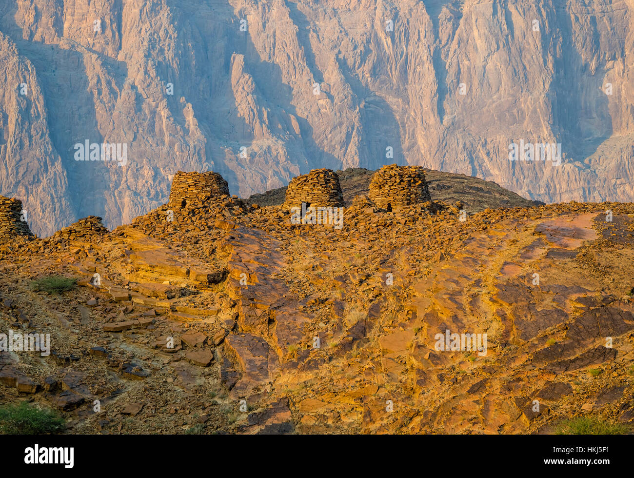 Archaeological site of Al-Ayn, beehive tombs, Jabal Misht mountains at back, Al Hajar Mountains, Al Dhahirah Region, - Stock Image