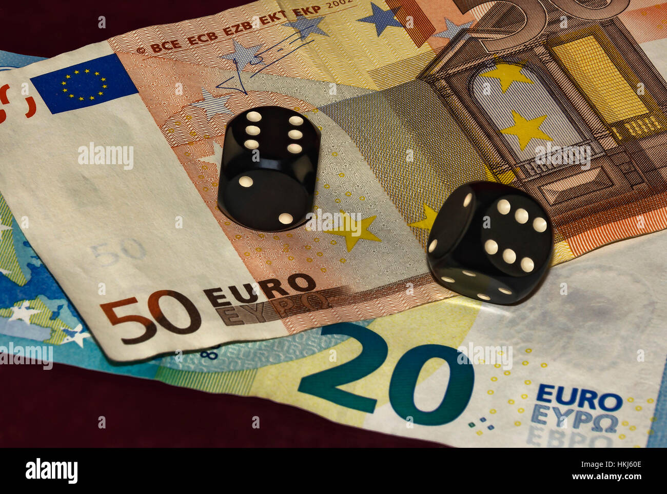 Two Black Poker Cube And Two Close Up Bills Stock Photo Alamy