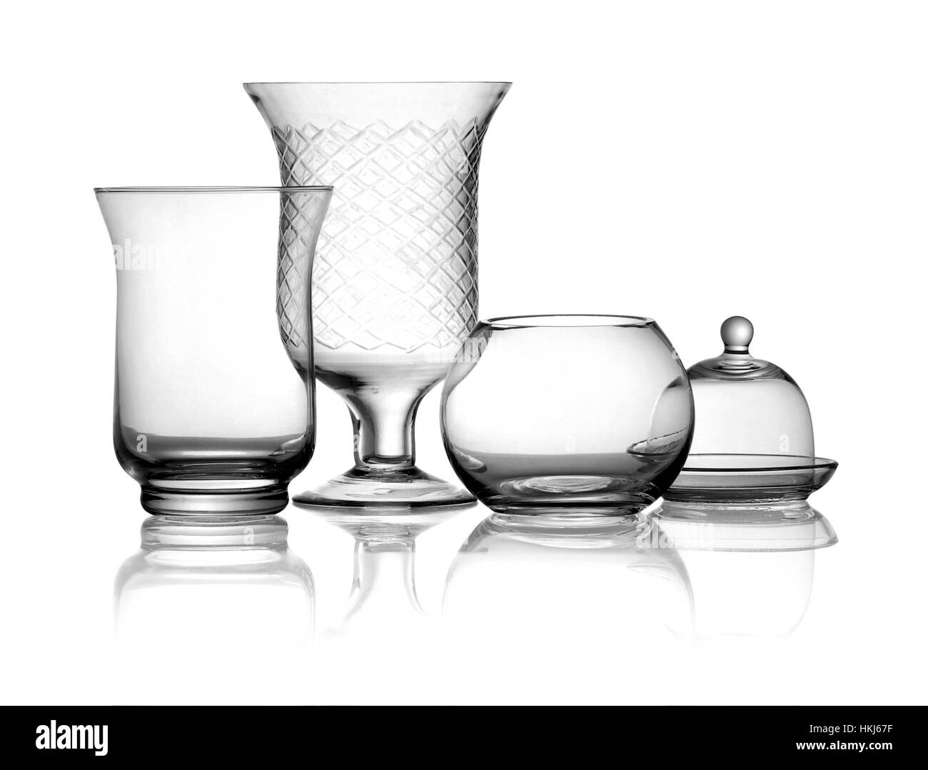 Front view of transparent glass jars and vases utensil, with reflection isolated on white background - Stock Image