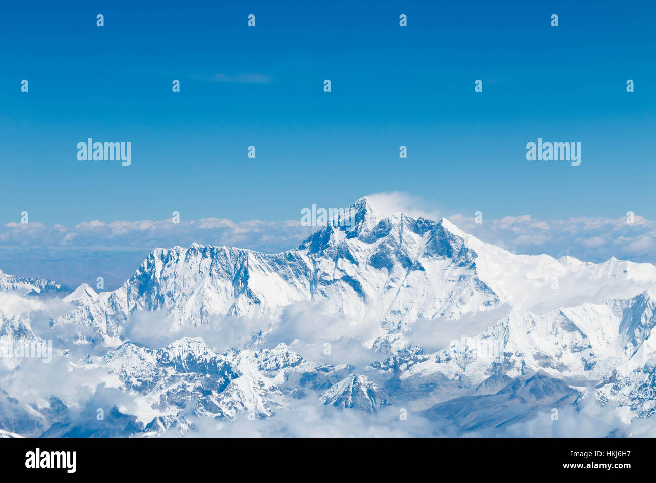 Mount Everest with Himalaya mountain range summit Peak view Aerial from a plane flyby Panorama landscape - Stock Image