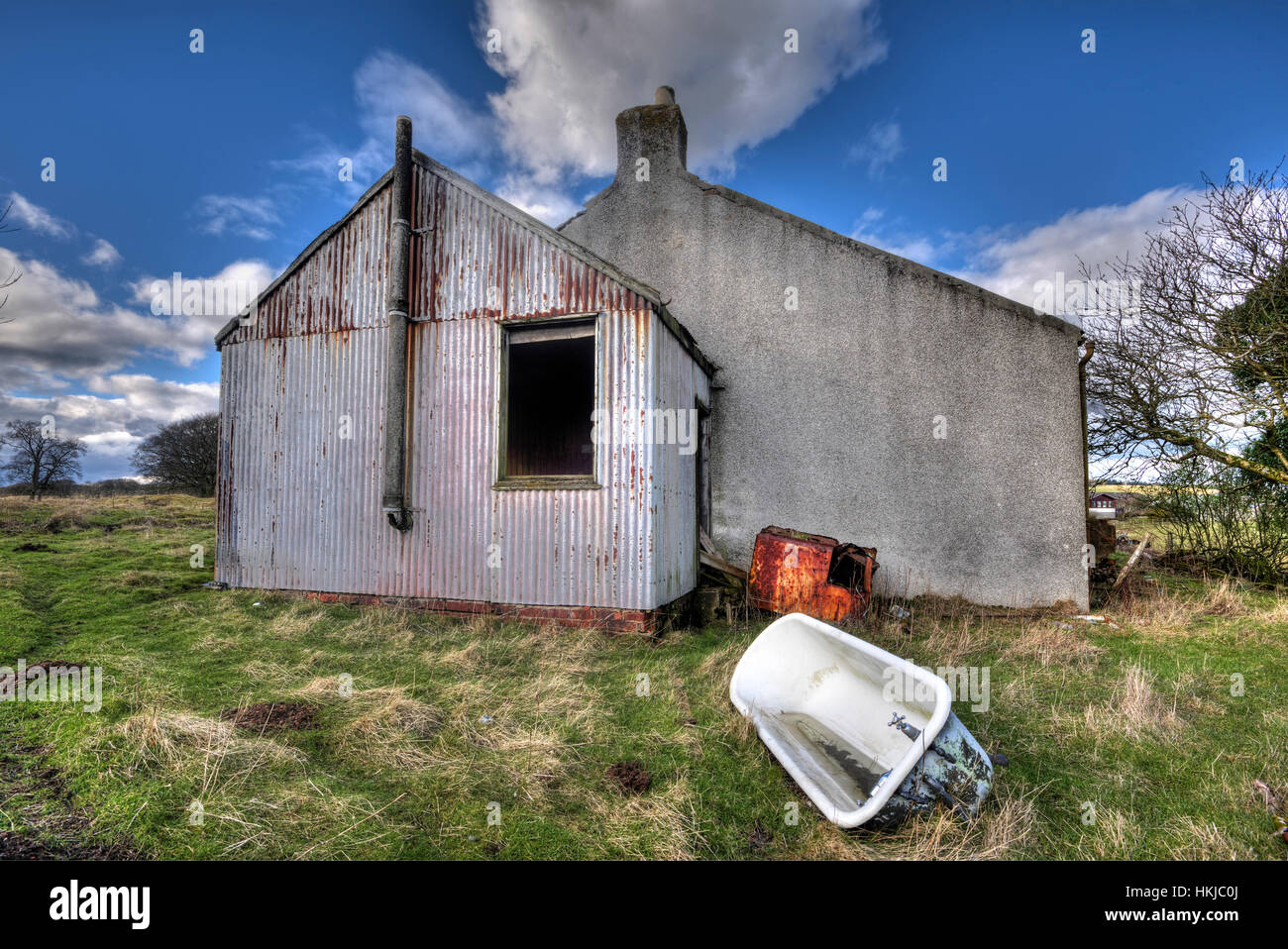 Derelict cottage and car near the small village of Forth Lanarkshire. - Stock Image
