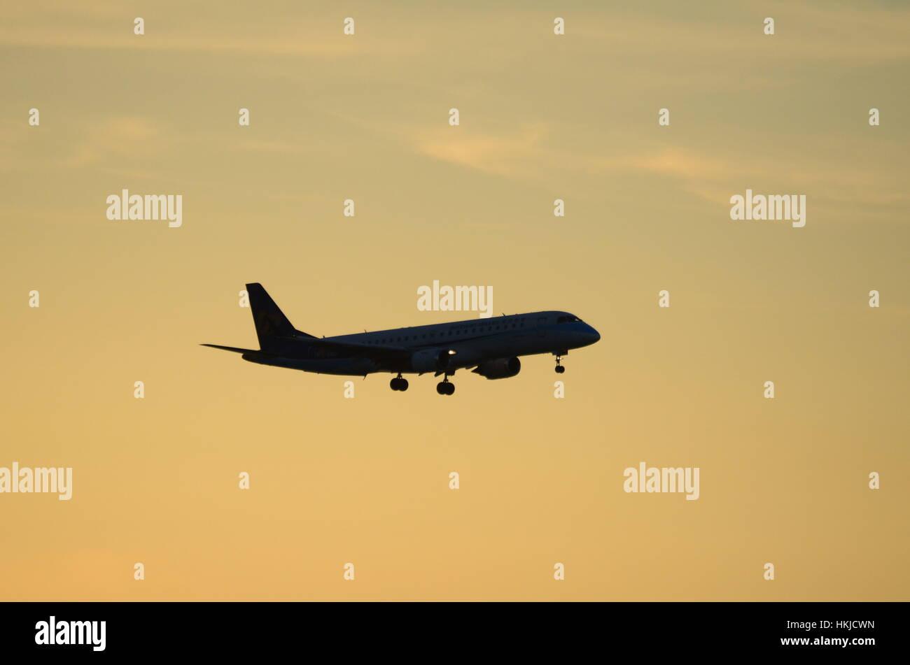 Mandarin Airlines Embraer E190 B-16822 landing at Hong Kong International Airport - Stock Image