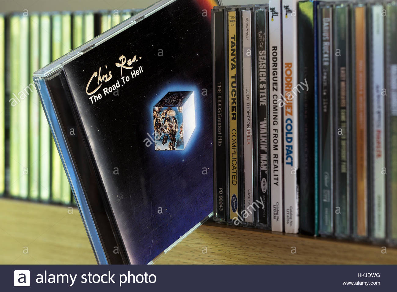 The Road To Hell, Chris Rea CD pulled out from among other CD's on a shelf - Stock Image