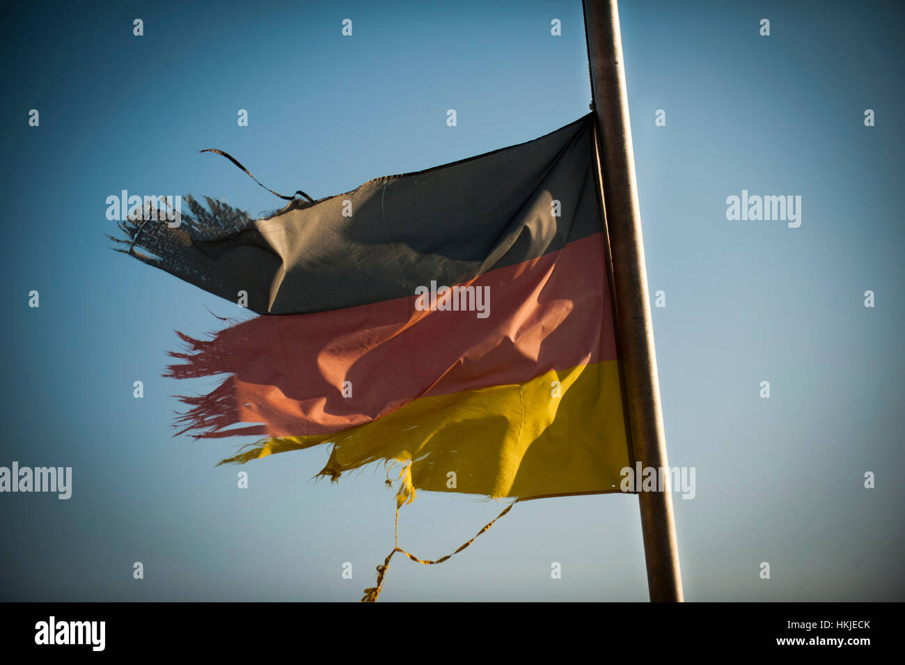 A battered and torn German Flag. - Stock Image