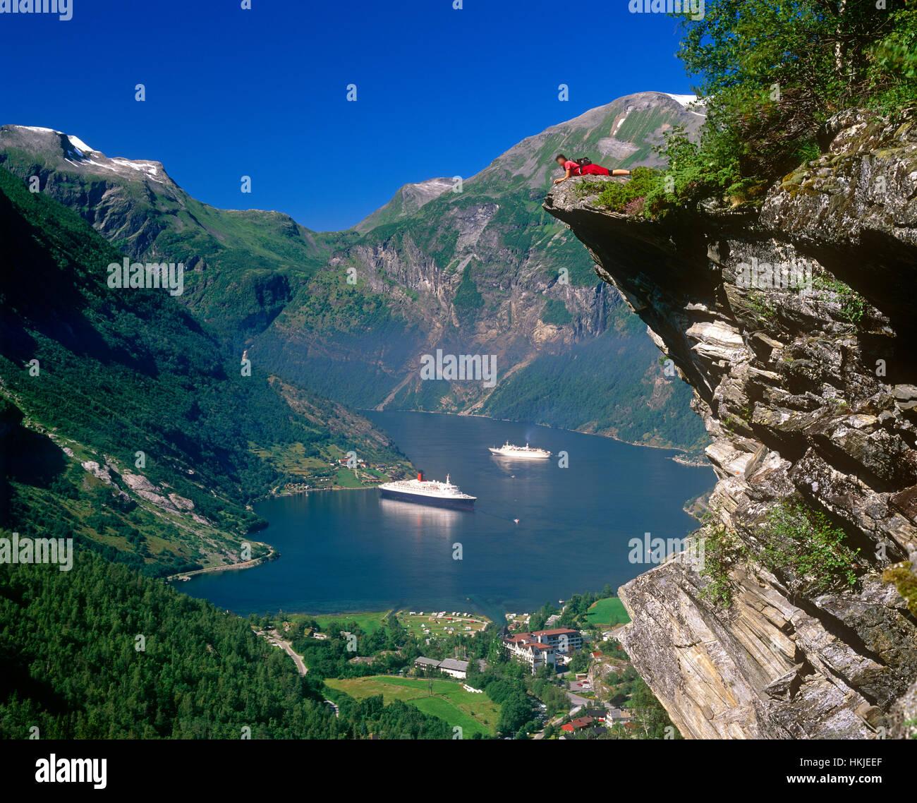 Tourist admiring Geirangerfjord, More og Romsdal, Norway23 - Stock Image