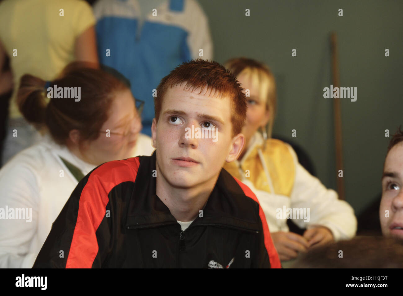 Youth in Castlemilk watch a TV programme about offending, crime and punishment Stock Photo