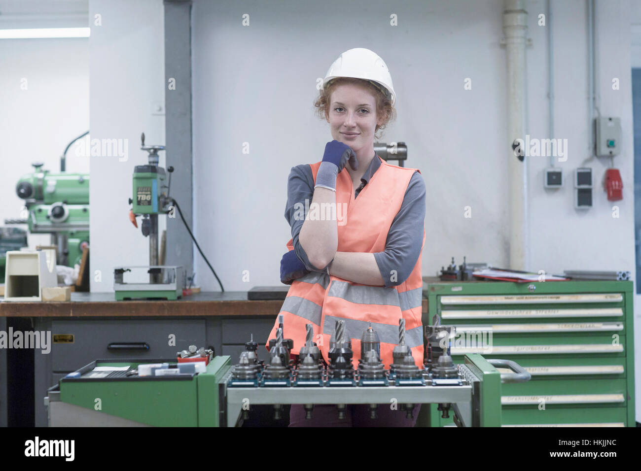 Young female engineer working in an industrial plant, Freiburg im Breisgau, Baden-Württemberg, Germany - Stock Image