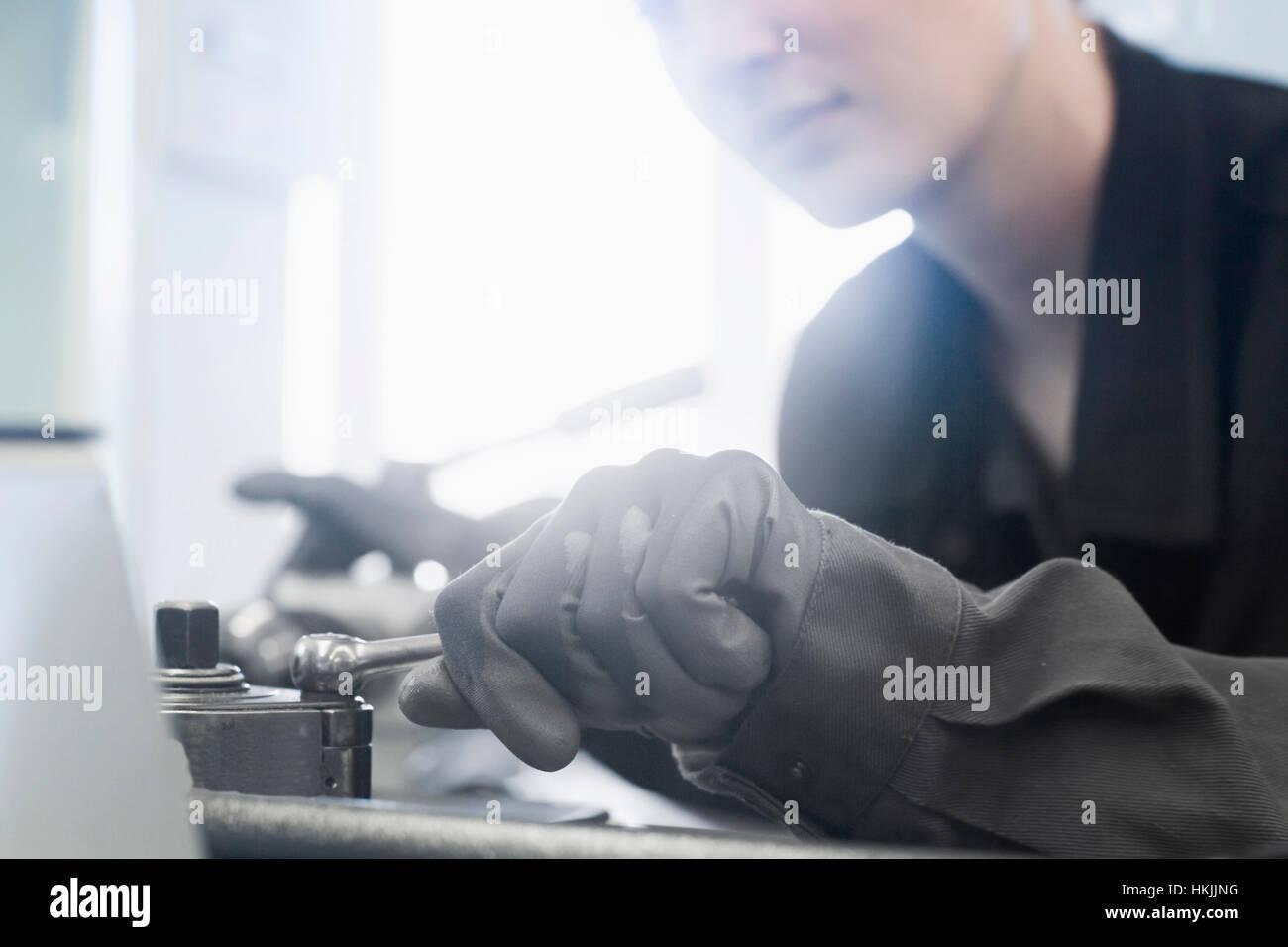 Female engineer in workshop with a lever in hand, Freiburg im Breisgau, Baden-Württemberg, Germany - Stock Image