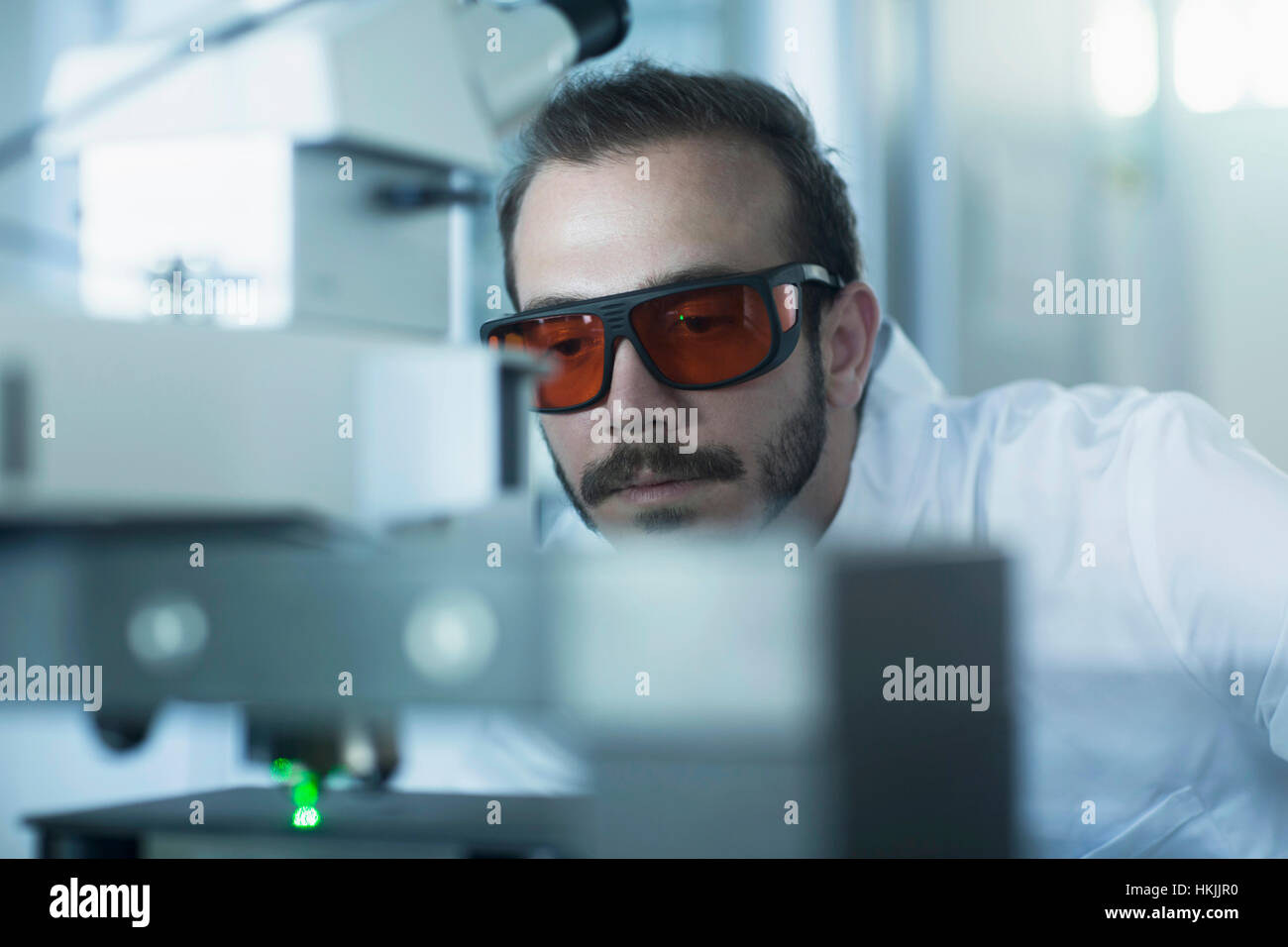 Young male scientist working in technology space, Freiburg Im Breisgau, Baden-Württemberg, Germany - Stock Image