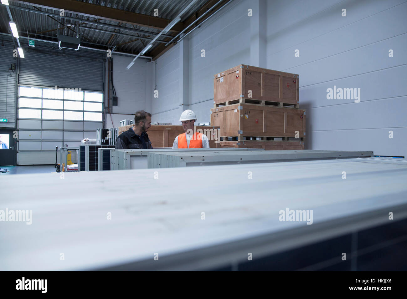 Store workers working in a distribution warehouse, Freiburg im Breisgau, Baden-Württemberg, Germany - Stock Image