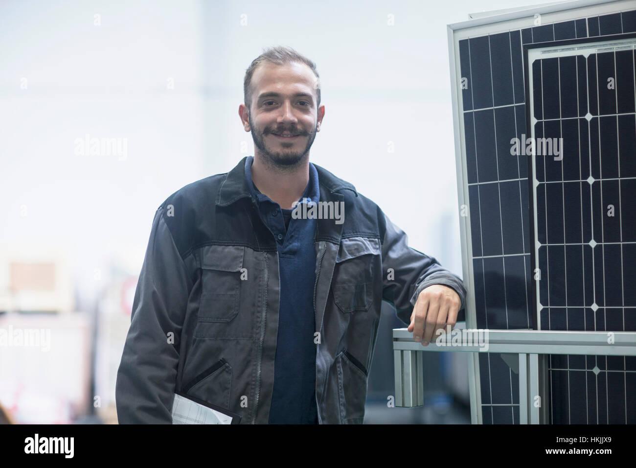 Confident store worker in warehouse, Freiburg im Breisgau, Baden-Württemberg, Germany - Stock Image